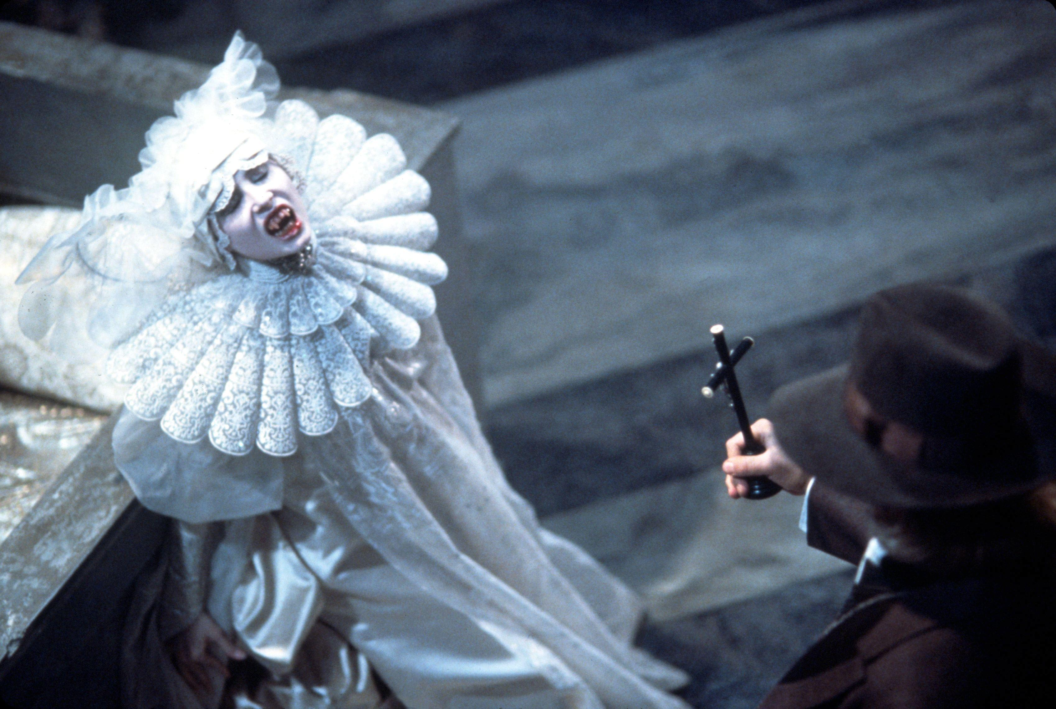 1992, Film Title: BRAM STOKER'S DRACULA, Director: FRANCIS FORD COPPOLA, Studio: COLUMBIA, Pictured: 1992, DRACULA & OTHER VAMPIRES, SADIE FROST, ANTHONY HOPKINS, TEETH, BLOOD, CRUCIFIX, LACE.